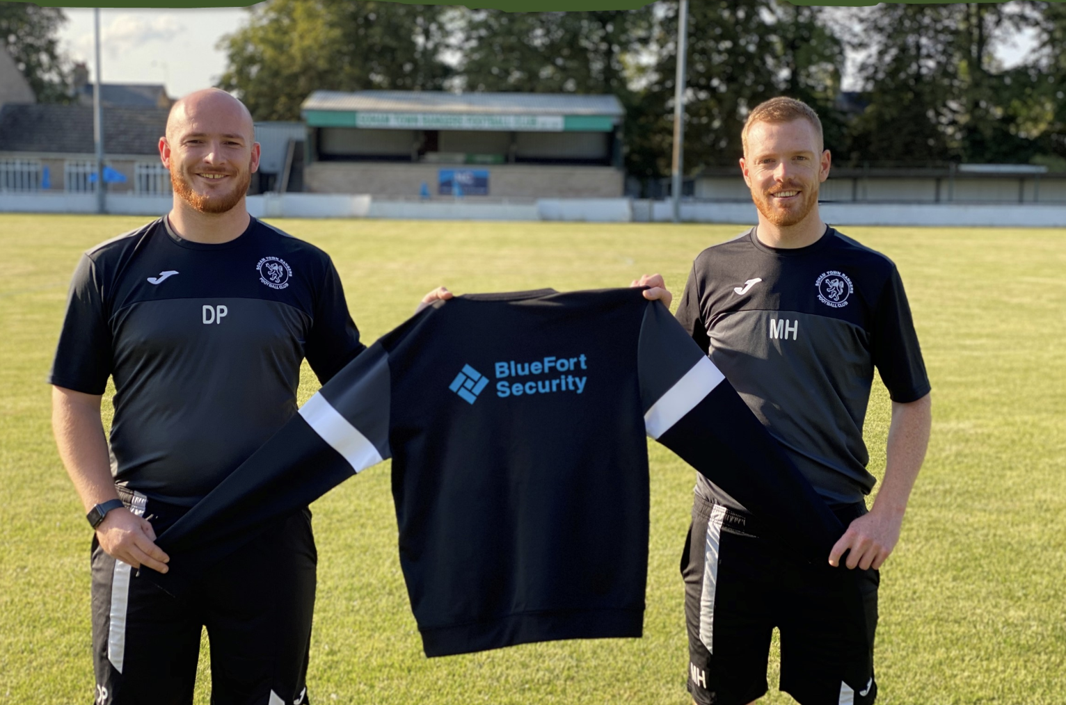 Left to Right  Dan Pratt, STRR Club Manager and Michael Harvey, STRR Head Coach with one of their new training shirts